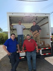 Clockwise from upper left: Business Rep. Jeff Rush, Training Coordinator Rob Gartner, Business Rep. Mike Tipton and Business Rep. Jeff Hunley load a truck with donations for Hurricane Irma relief.